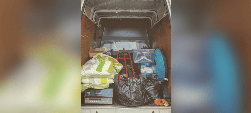 Photo of the back of a van full of stuff